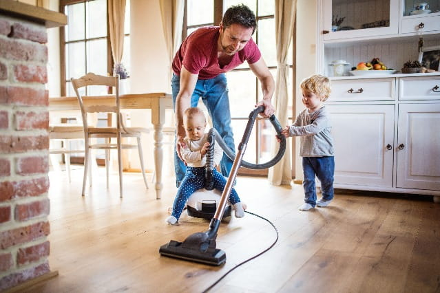Father and two toddlers doing house cleaning in Toronto